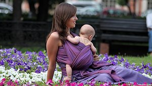 Pregnancy, birth and babies. mother and baby in purple sling shot wide version