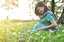 Pregnancy, birth and babies. pregnant woman smiling in nature